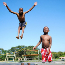 Kids Jumping On The Trampoline